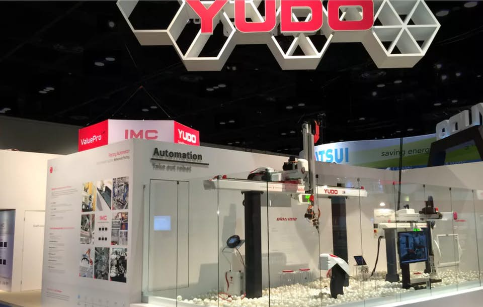 Example of a creative stunt at a trade show by the company Yudo.