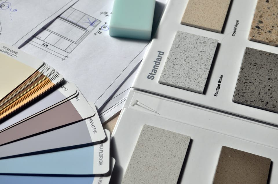 Paint color options and flooring options for a custom trade show exhibit.