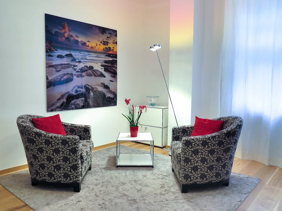 Two comfy chairs in trade show exhibit lounge area.