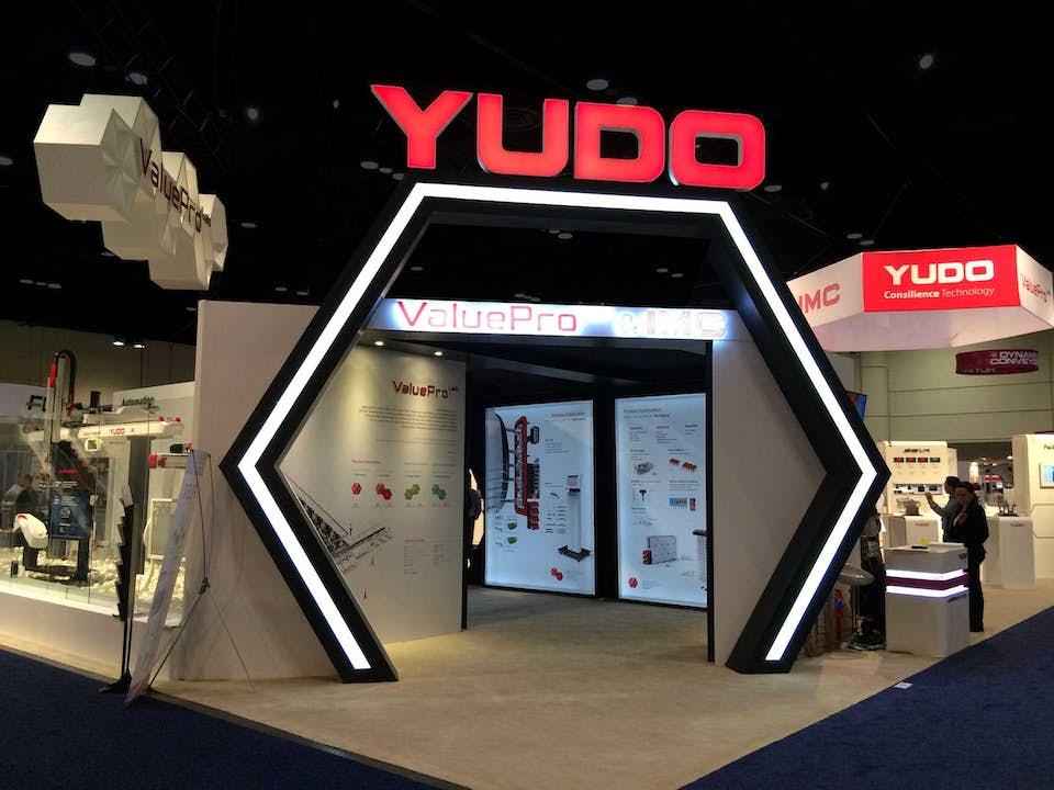 Yudo trade show exhibit honeycomb header designed by BTWN Exhibits.